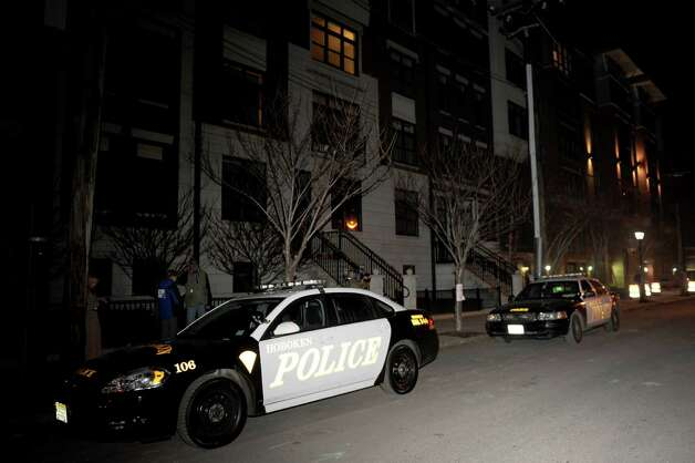 Police activity continues outside the apartment of Ryan Lanza in Hoboken, New Jersey, on Friday, December 14, 2012. Lanza's brother, Adam, is the alleged shooter who killed 20 children and 6 adults at Sandy Hook Elementary School in Newtown, Conn. Photo: Lindsay Niegelberg, Niegelberg / Stamford Advocate