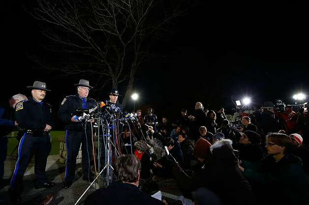 NEWTOWN, CT - DECEMBER 14:  Connecticut State Police spokesman Lt. J. Paul Vance (C) briefs the media on the elementary school shootings during a press conference at Treadwell Memorial Park on December 14, 2012 in Newtown, Connecticut. According to reports, 27 are dead, including 20 children, after a gunman identified as Adam Lanza in news reports, opened fire in at the Sandy Hook Elementary School in Newtown.  Lanza also reportedly died at the scene. (Photo by Jared Wickerham/Getty Images) Photo: Jared Wickerham, Getty Images