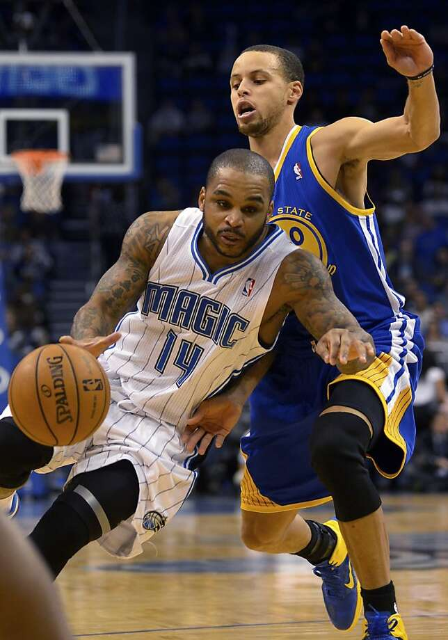Orlando Magic guard Jameer Nelson (14) drives past Golden State Warriors guard Stephen Curry during the first half of an NBA basketball game in Orlando, Fla., Friday, Dec. 14, 2012. (AP Photo/Phelan M. Ebenhack) Photo: Phelan M. Ebenhack, Associated Press