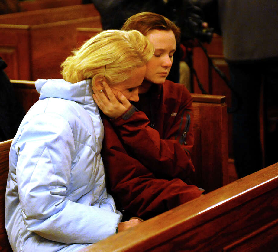 The community gathered at St. Rose of Lima Church in Newtown, Conn. on Friday December 14, 2012 to mourn the victims of the mass shooting at Sandy Hook Elementary School earlier in the day. Photo: Christian Abraham / Connecticut Post