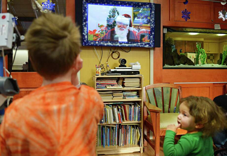 Patients Aiden Raffe, left, 9, of Delmar and Karina Bullock, 2, of Rosendale, NY, during a virtual visit from Santa at Albany Med?s Children?s Hospital Friday Dec. 14, 2012.  (John Carl D'Annibale / Times Union) Photo: John Carl D'Annibale / 00020471A