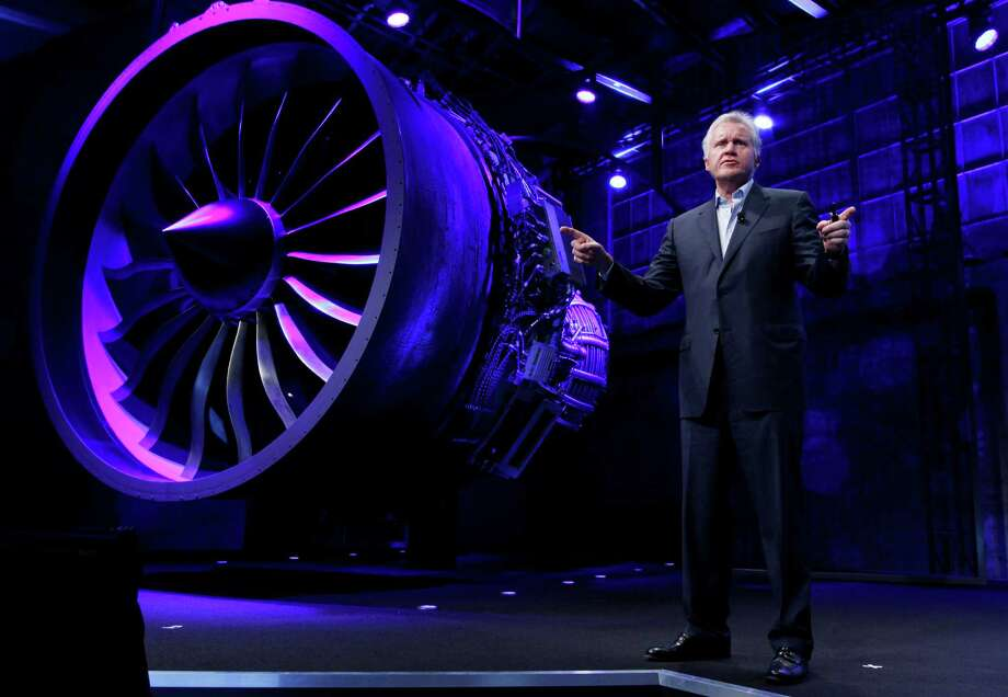 In this photo provided by General Electric, GE CEO and Chairman Jeff Immelt, stands in front of a jet engine during the Mind + Machines 2012 event in San Francisco, Thursday, Nov. 29, 2012. Photo: Associated Press / Associated Press