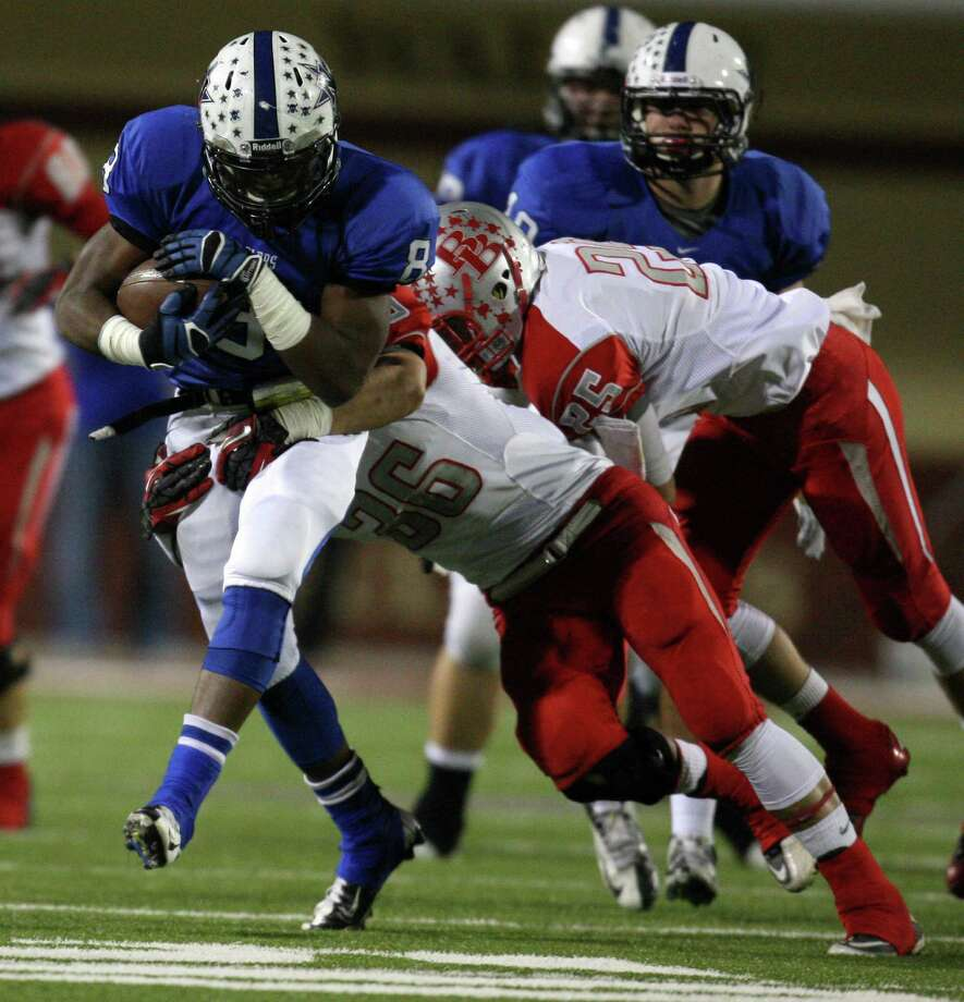 Navasota's Xavier Creeks (8) is tackled by Bellville's Angel Rodrigues (36) during the first half of a Class 3A state semifinal high school football game, Friday, December 14, 2012 at Waller ISD Stadium in Waller, TX. Photo: Eric Christian Smith, For The Chronicle