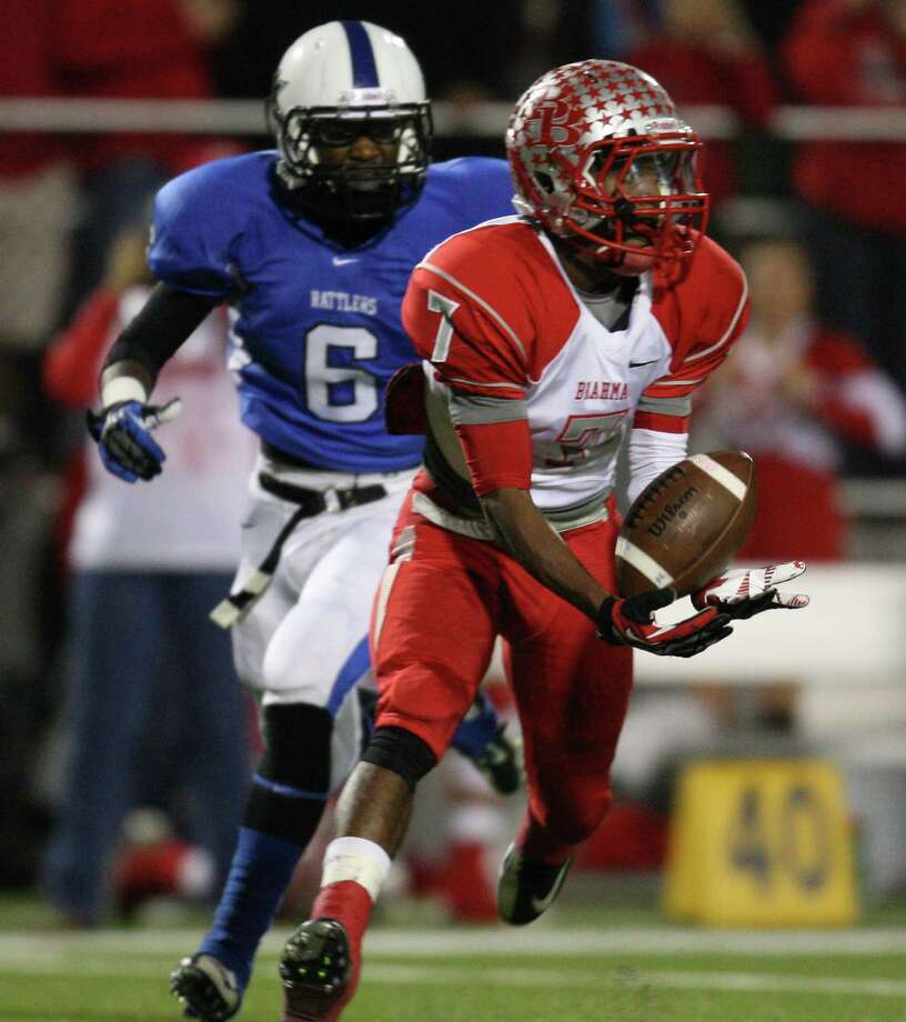 Bellville's DeBrae Parker (7) makes a reception past Navasota's Deiontee Taylor (6) during the first half of a Class 3A state semifinal high school football game, Friday, December 14, 2012 at Waller ISD Stadium in Waller, TX. Photo: Eric Christian Smith, For The Chronicle