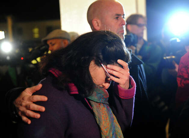 Residents attend a memorial service at St. Rose of Lima Church in Newtown, Conn., on Friday, Dec. 14, 2012. Photo: Christian Abraham / Connecticut Post
