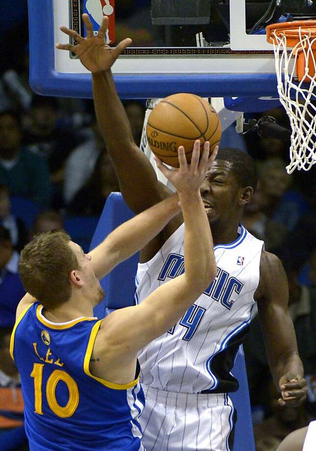Orlando Magic forward Andrew Nicholson blocks a shot by Golden State Warriors forward David Lee during the first half of an NBA basketball game in Orlando, Fla., Friday, Dec. 14, 2012. The Magic won 99-85. (AP Photo/Phelan M. Ebenhack) Photo: Phelan M. Ebenhack, Associated Press