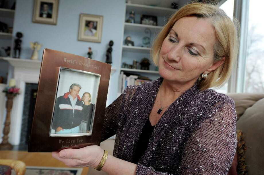 Eileen Clinton holds a photo of her and her late husband taken on his 50th birthday in her home on Friday Dec. 14, 2012 in East Greenbush, N.Y.  Clinton, whose husband, William Champagne, died of lung cancer, won a $1.34 million lawsuit against tobacco giant RJ Reynolds. (Lori Van Buren / Times Union) Photo: Lori Van Buren