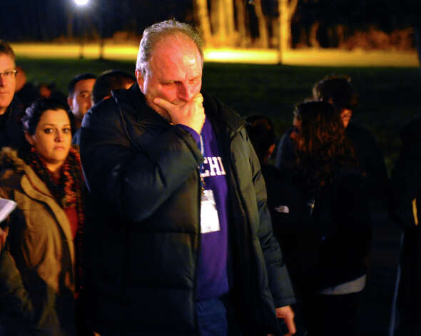 During a memorial service at St. Rose of Lima Church, Ray Horvath, who worked with children at Sandy Hook Elementary School, becomes emotional after learning that one of the children he worked with died in the mass shooting earlier in the day. Photo: Christian Abraham / Connecticut Post