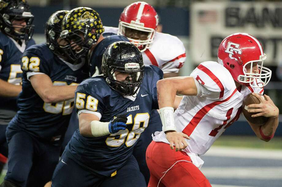 El Campo quarterback Bryce Brandl (14) gets past Stephenville defensive lineman Jacoby Miller-Selem on a touchdown run. Photo: Smiley N. Pool, Houston Chronicle / © 2012  Houston Chronicle