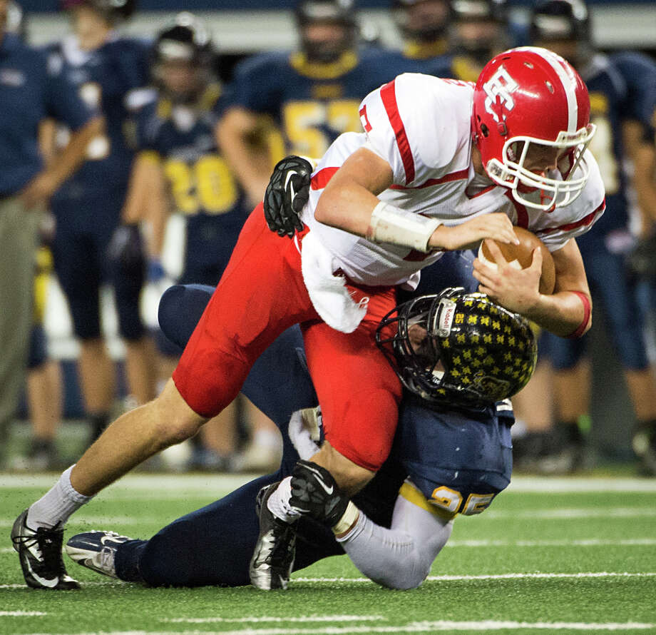 El Campo quarterback Bryce Brandl (14) is brought down by Stephenville defensive end Chase Varnado. Photo: Smiley N. Pool, Houston Chronicle / © 2012  Houston Chronicle