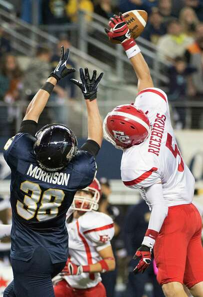El Campo defensive back Michael Wall (5) breaks up a pass intended for Stephenville tight end Brock