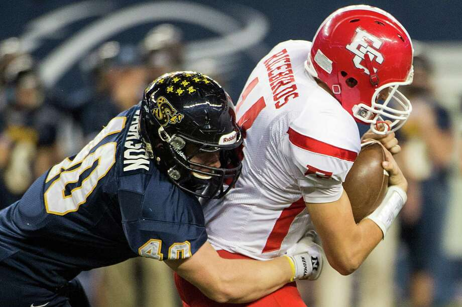 El Campo quarterback Bryce Brandl (14) is brought down by Stephenville linebacker David Jackson. Photo: Smiley N. Pool, Houston Chronicle / © 2012  Houston Chronicle