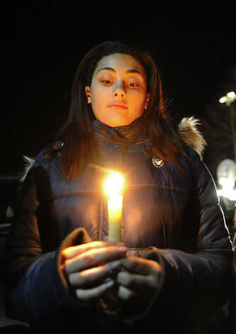 Tiana Dwyer holds a candle outside as hundreds of area residents gather for a memorial service for victims of today's mass shooting earlier at Sandy Hook Elementary School held at St. Rose of Lima Church in Newtown, Conn. on Friday December 14, 2012. Photo: Christian Abraham / Connecticut Post