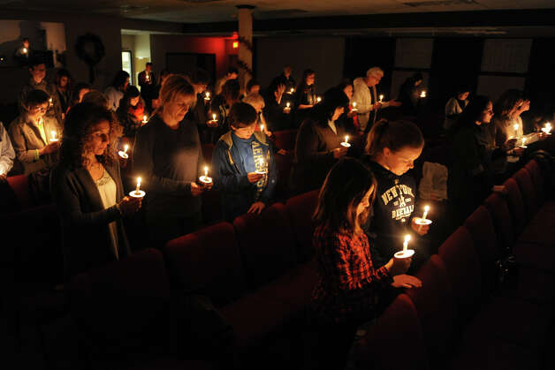 A candle light vigil during a service at Grace Family Church, in Newtown, Conn. Dec. 14th, 2012. The service was held following the mass shooting at Sandy Hook Elementary School Friday morning. Photo: Ned Gerard / Connecticut Post