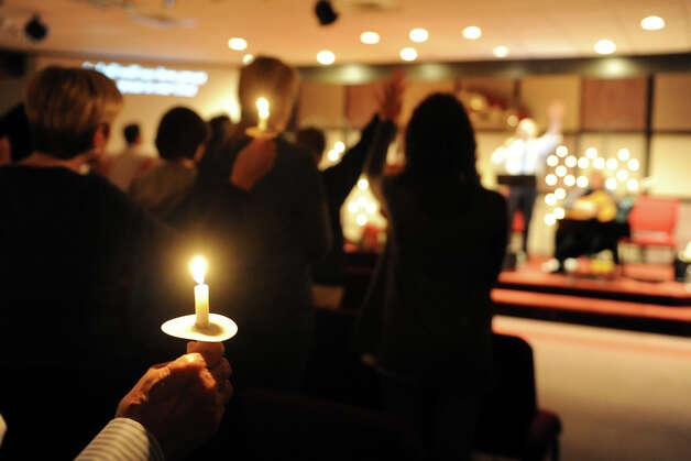 Candles during a service at Grace Family Church, in Newtown, Conn. Dec. 14th, 2012. The service was held following the mass shooting at Sandy Hook Elementary School Friday morning. Photo: Ned Gerard / Connecticut Post
