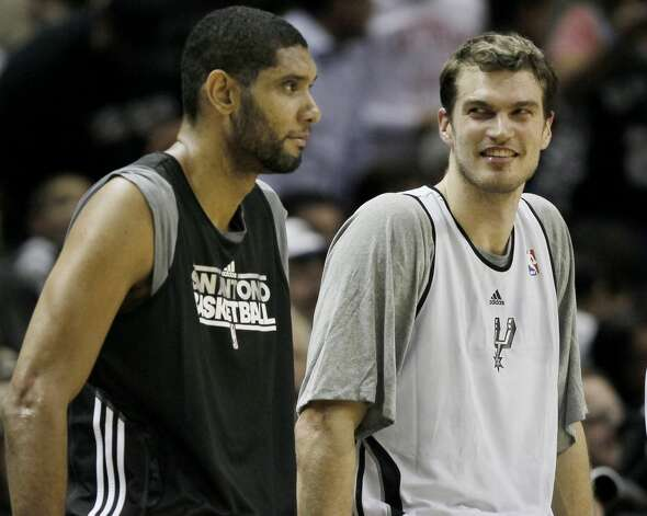 San Antonio Spurs players Tiago Splitter, right, of Brazil, and Tim Duncan talk on the court during an NBA basketball scrimmage, Monday, Dec. 19, 2011, in San Antonio. (Darren Abate/Special to the Express-News) (SPECIAL TO THE EXPRESS-NEWS)