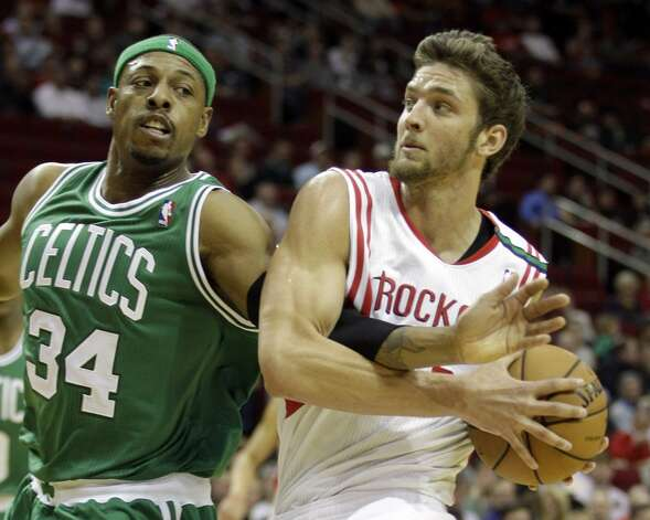 Celtics forward Paul Pierce fouls Rockets forward Chandler Parsons during first half. (Melissa Phillip / Houston Chronicle)