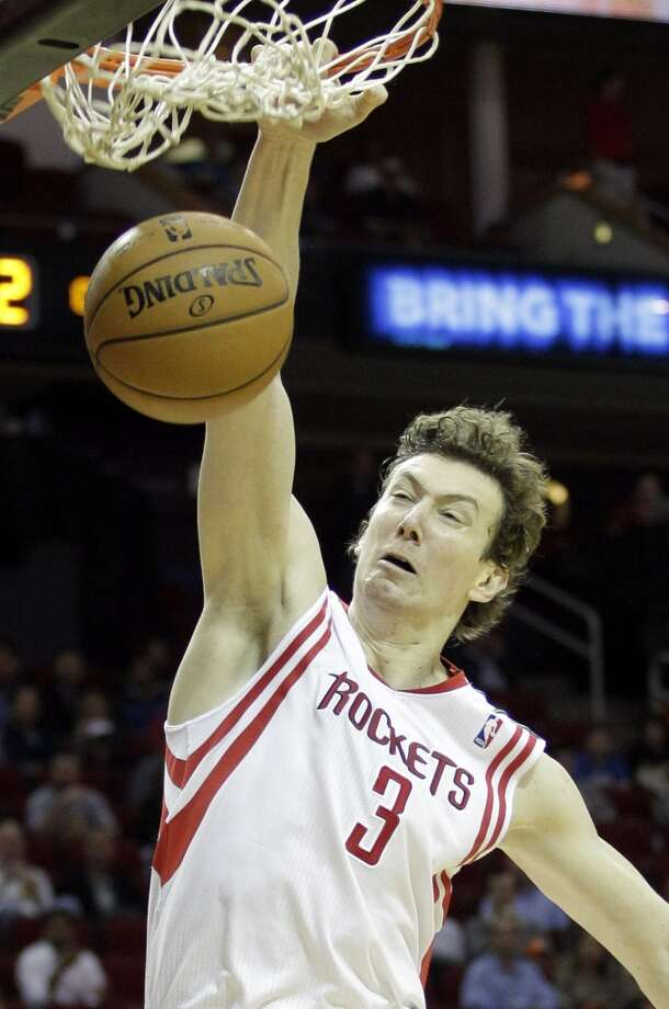 Rockets center Omer Asik dunks the ball against the  Celtics.  (Melissa Phillip / Houston Chronicle)