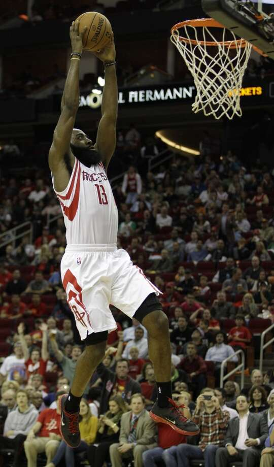 James Harden dunks the ball against the Boston Celtics during the second half. (Melissa Phillip / Houston Chronicle)