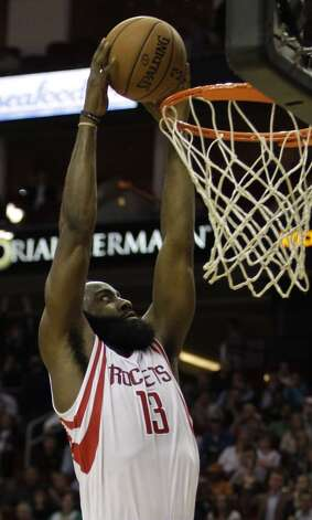 Rockets guard James Harden dunks the ball against the Boston Celtics during the second half. (Melissa Phillip / Houston Chronicle)