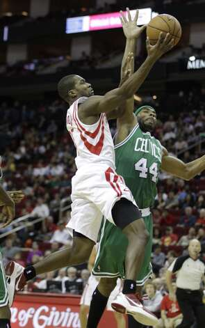 Rockets guard Toney Douglas works to shoot past Celtics forward Chris Wilcox. (Melissa Phillip / Houston Chronicle)