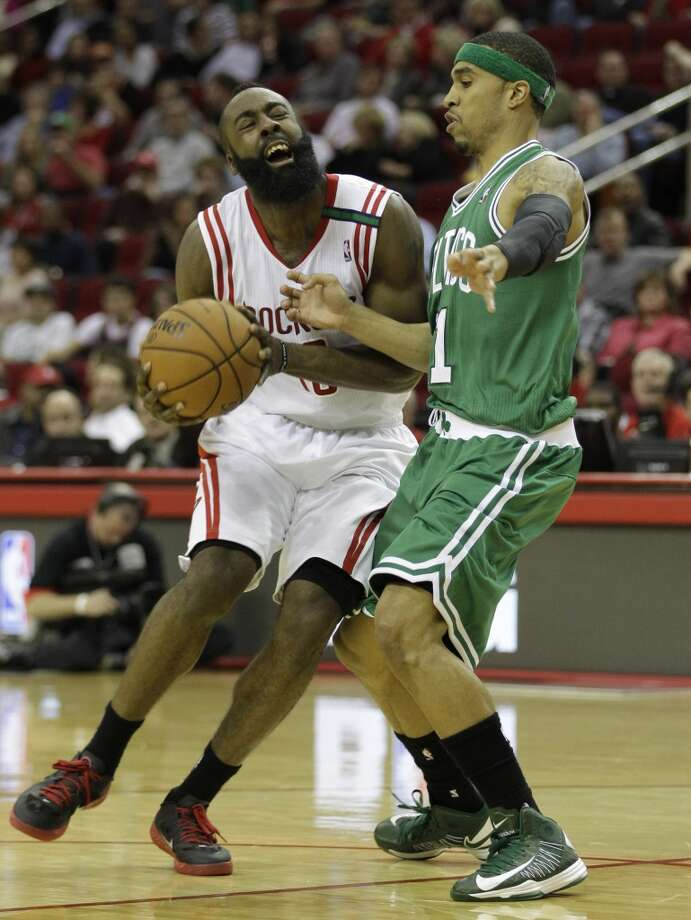 Rockets guard James Harden is fouled by Celtics guard Courtney Lee during the second half. (Melissa Phillip / Houston Chronicle)