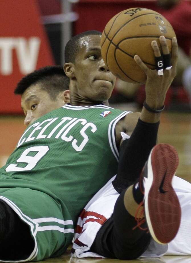 Celtics guard Rajon Rondo looks to pass the ball after beating Rockets guard Jeremy Lin during a scramble on the floor. (Melissa Phillip / Houston Chronicle)