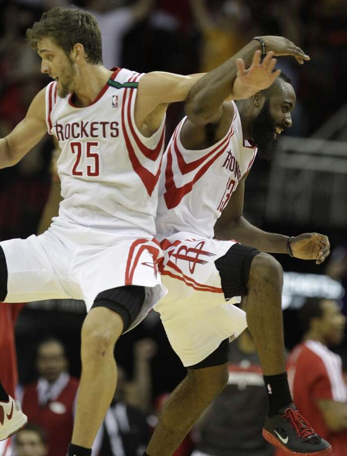 Chandler Parsons and James Harden of the Rockets celebrate after a 3-point shot by teammate Toney Douglas. (Melissa Phillip / Houston Chronicle)