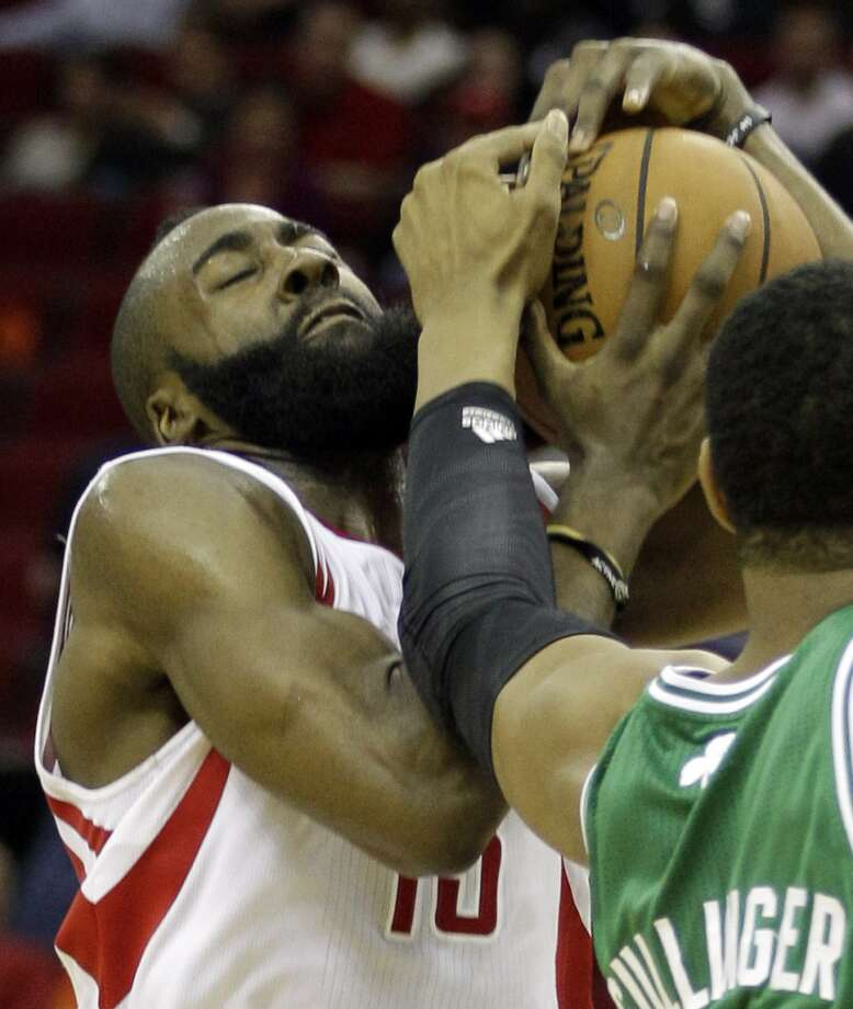 Rockets guard James Harden goes up for a shot as Celtics forward Jared Sullinger defends. (Melissa Phillip / Houston Chronicle)