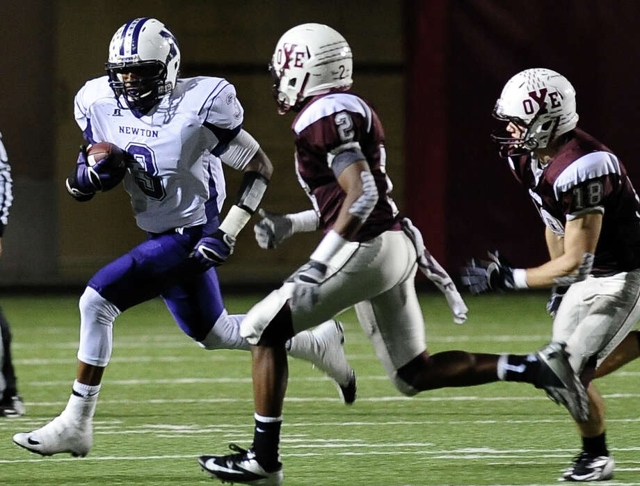 Newton running back Kevin Shorter, #3, charges down the field for a first down during the Newton High School Class 2A Division I state semifinal game against Cameron Yoe at the Woodforest Bank Stadium in Shenandoah, TX on December, 14, 2012. Photo taken: Randy Edwards/The Enterprise Photo: Randy Edwards