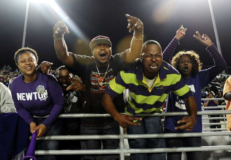 Newton fans go wild during the Newton High School Class 2A Division I state semifinal game against C