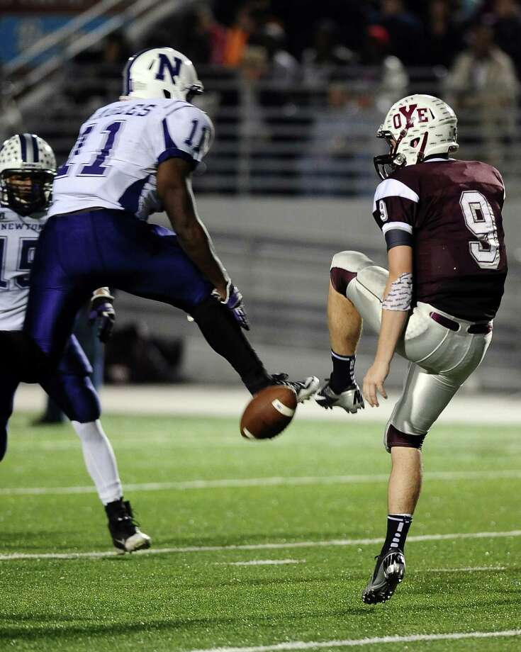 Newton  running back Anthony Hadnot, #11, blocks the punt that is picked up by Romando Stewart, #15, and scored another Eagle touchdown during the Newton High School Class 2A Division I state semifinal game against Cameron Yoe at the Woodforest Bank Stadium in Shenandoah, TX on December, 14, 2012. Photo taken: Randy Edwards/The Enterprise Photo: Randy Edwards