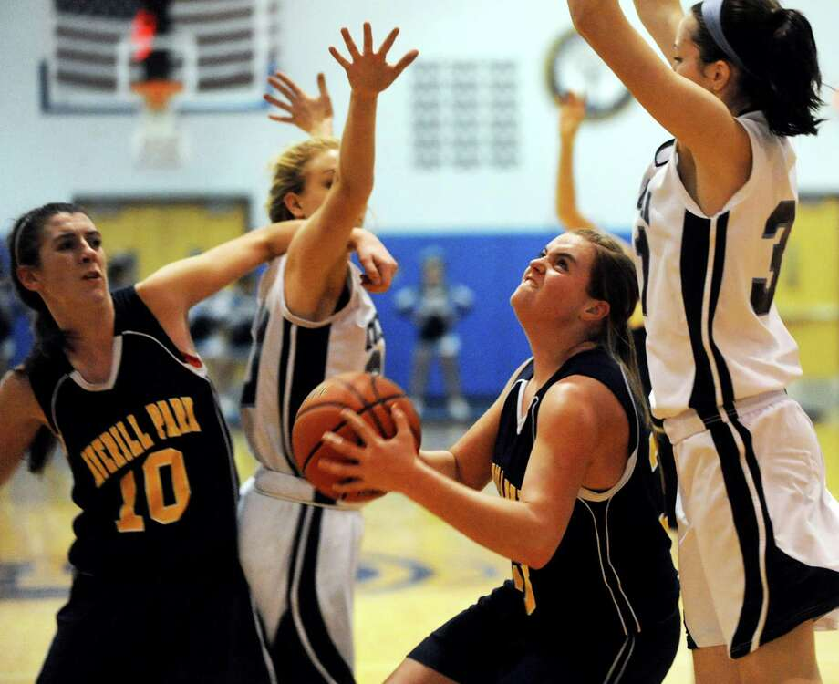 Averill Park's Caraline Wood (33), center, runs into heavy traffic as she tries to shoot for the hoop during their basketball against Columbia on Friday, Dec. 14, 2012, at Columbia High in East Greenbush, N.Y. (Cindy Schultz / Times Union) Photo: Cindy Schultz / 00020456A