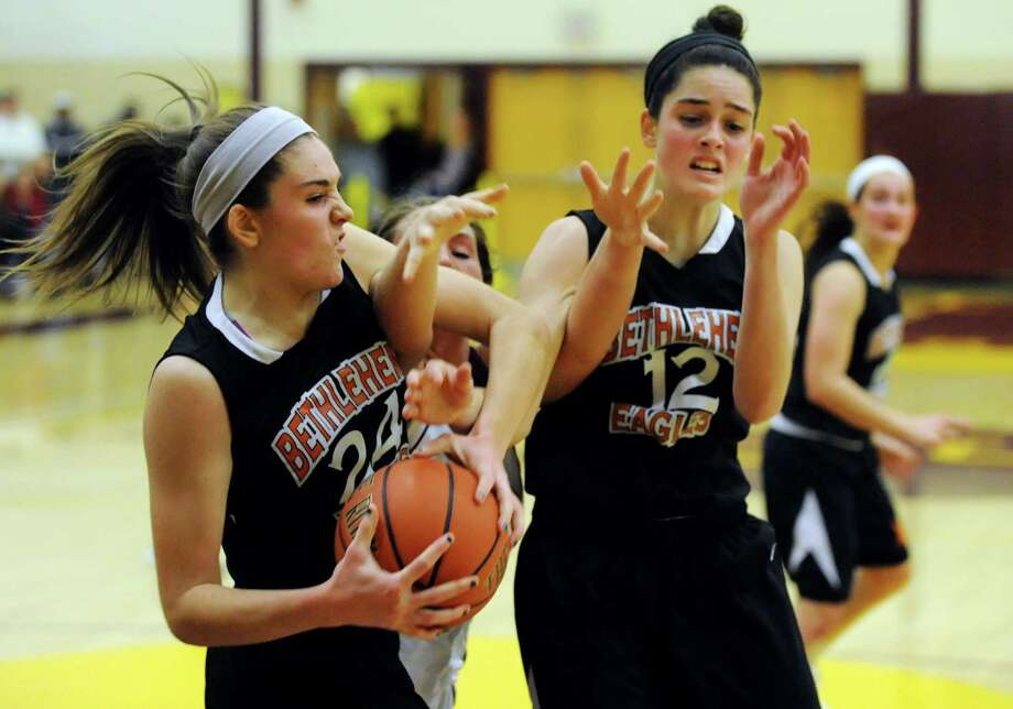 Bethlehem's Gabby Giacone (24), left, and her sister Jenna Giacone (12), right, battle for a loose ball with Colonie's Kelly Lane (25), center, during their basketball on Friday, Dec. 14, 2012, at Colonie High in Colonie, N.Y. (Cindy Schultz / Times Union) Photo: Cindy Schultz / 00020445A