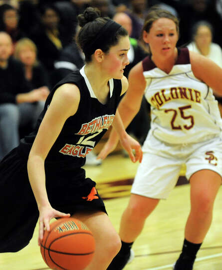 Bethlehem's Jenna Giacone (12), left, takes control of the ball as Colonie's Kelly Lane (25) defends
