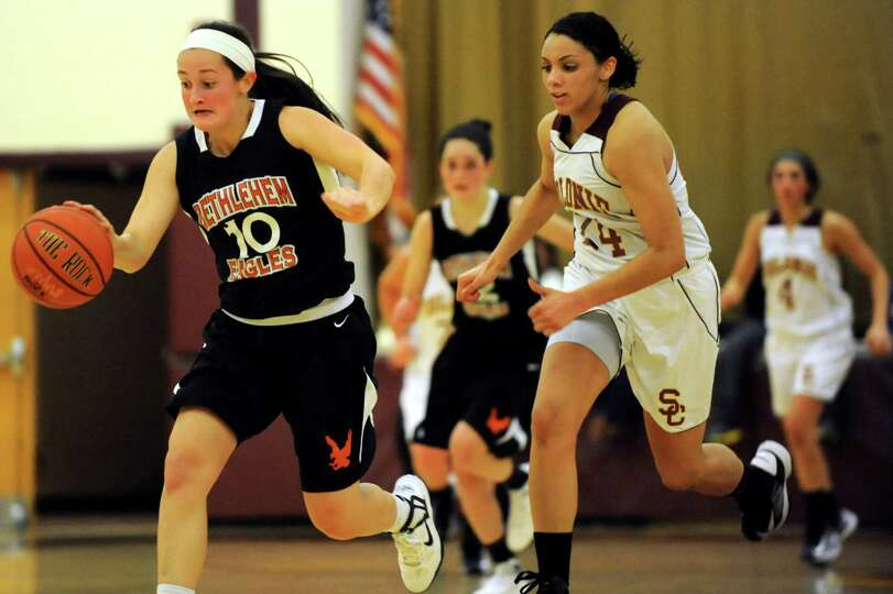 Bethlehem's Kaylee Rickert (10), left, steals the ball as Colonie's Sydnie Rosales (24) defends duri