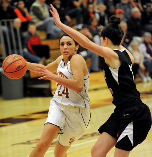 Colonies Sydnie Rosales (24), left, drives to the hoop as Bethlehem's jenna Giacone (12) defends dur