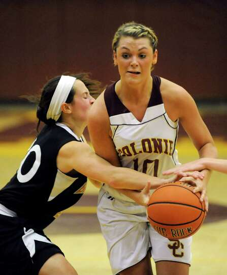 Colonie's Jaclyn Welch (10), right, works the paint as Bethlehem's Kaylee Rickert (10) defends durin