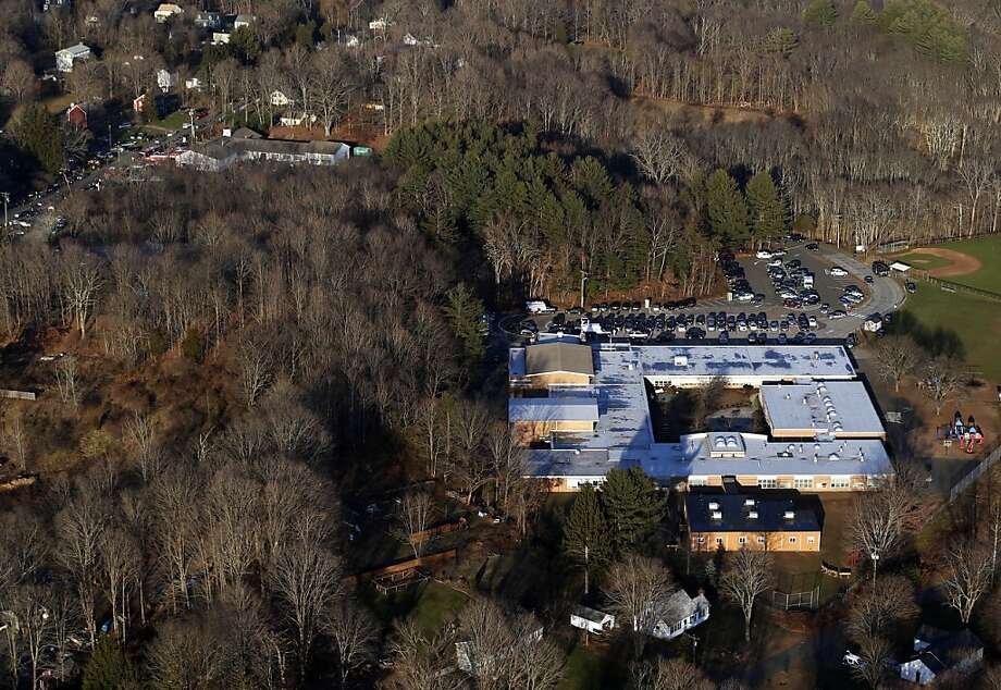 This aerial photo shows Sandy Hook Elementary School in Newtown, Conn., right, where authorities say a gunman opened fire inside the school in a shooting that left 27 people dead, including 20 children, Friday, Dec. 14, 2012. (AP Photo/Julio Cortez) Photo: Julio Cortez, Associated Press
