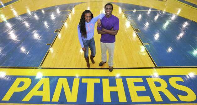Ozen High School athletes Bealoved Brown, left, and her younger brother Tony Brown.  Dave Ryan/The Enterprise Photo: Dave Ryan