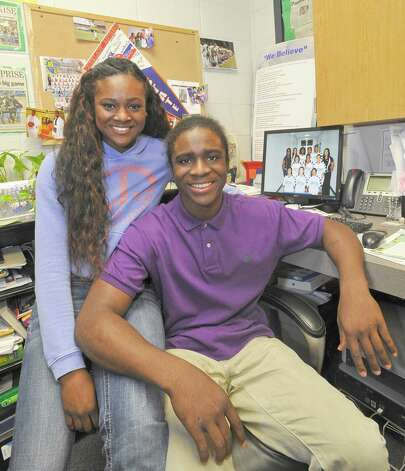 Ozen High School athletes Bealoved Brown, left, and her younger brother Tony Brown, right, talk about their futures and the college offers they have already received while sitting in their mother's office who is the Ozen girls basketball coach Tammy Walker-Brown.   Dave Ryan/The Enterprise Photo: Dave Ryan