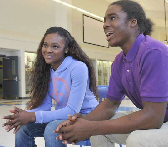Ozen High School athletes Bealoved Brown, left, and her younger brother Tony Brown, right, talk about their futures and the college offers they have already received.  Dave Ryan/The Enterprise Photo: Dave Ryan
