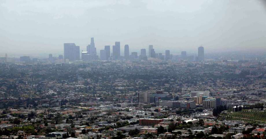 This April 28, 2009 file photo shows smog covering downtown Los Angeles. Southern California is seeing its worst smog levels since 2009. Photo: Nick Ut