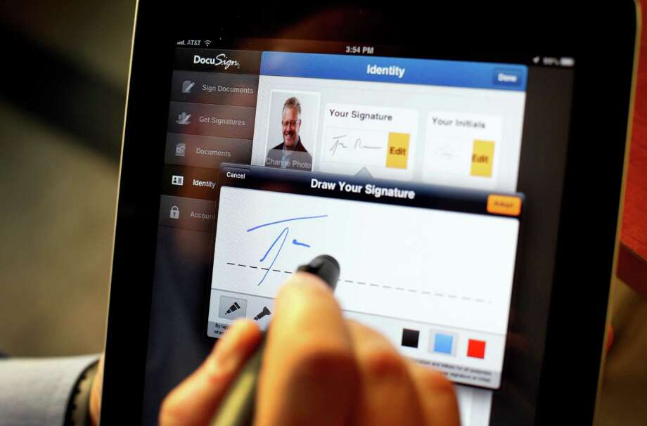 Tom Gonser, the founder and chief strategy officer for DocuSign, demonstrates how to capture a signature in San Francisco.  Many consider Gonser the father of the electronic signature. Photo: Sarah Rice / ONLINE_YES