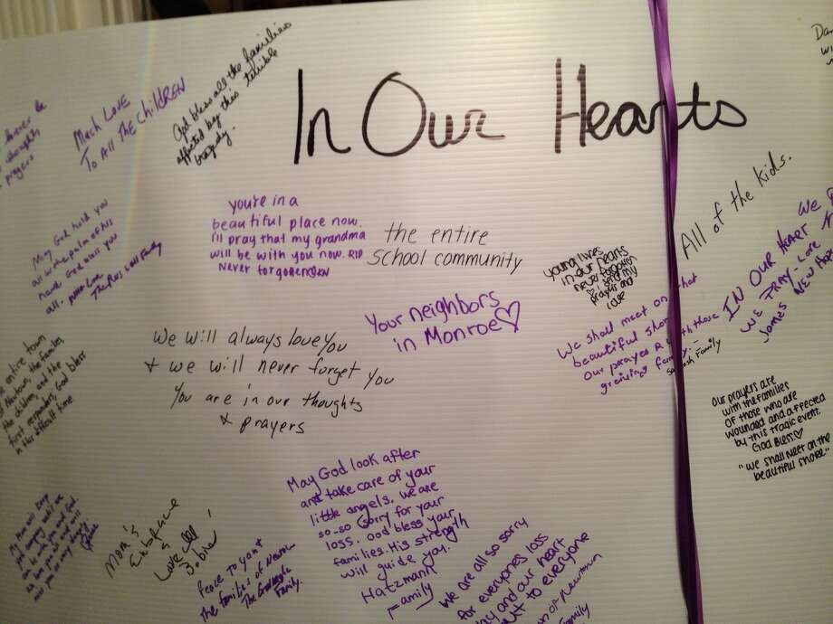 A condolence card is filled with writings at a ceremony for victims of the Newtown, Conn., massacre. (Paul Grondahl / Times Union)