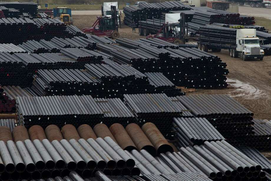 Steel pipes for hydraulic fracking are sorted by fork lifts and taken to freight trains for delivery, Thursday, Dec. 6, 2012, at the Port of Houston Authority in Houston.  ( Nick de la Torre / Houston Chronicle ) Photo: Nick De La Torre, Staff / © 2012  Houston Chronicle