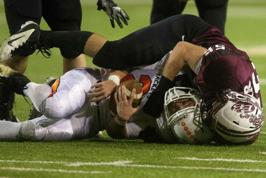 East Bernard defensive end Jordan Darr, top, tackles Elysian Fields' Tanner Davis as the Brahmas earn a ticket to their first state title game since losing the Class 2A final in 1982. Photo: J. Patric Schneider, Freelance / © 2012 Houston Chronicle