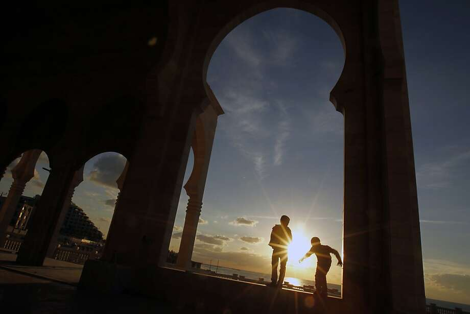 Palestinian children play outside a mosque in Gaza City as the sun sets on December 14, 2012. Photo: Mohammed Abed, AFP/Getty Images