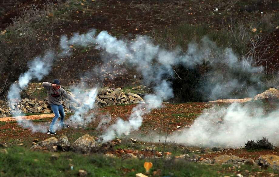 Clashes between Palestinian youth and Israeli soldiers near Ofer military prison, near the West Bank city of Ramallah, as protestors gathered following the 25th anniversary of the founding of Hamas on December 14, 2012. Photo: Abbas Momani, AFP/Getty Images