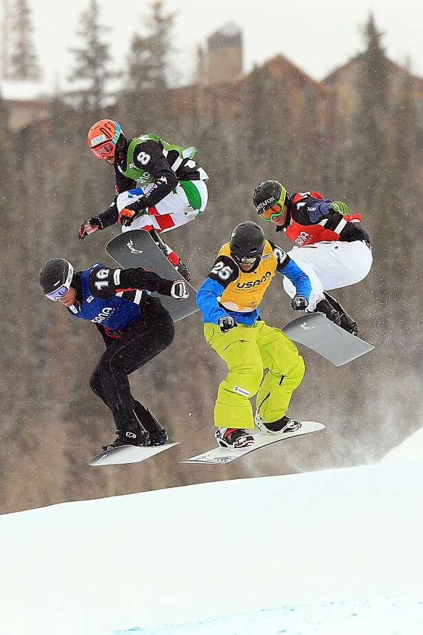 Lluis Marin Tarroch of Andorra, Tommaso Leoni of Italy, Marvin James of Switzerland and Markus Schairer of Austria compete in the eighth finals of the USANA Snowboardcross World Cup on December 14, 2012 in Telluride, Colorado. Photo: Doug Pensinger, Getty Images